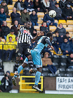 Stanley Aborah of Notts County beats Aaron Pierre of Wycombe Wanderers in th air during the Sky Bet League 2 match between Notts County and Wycombe Wanderers at Meadow Lane, Nottingham, England on 28 March 2016. Photo by Andy Rowland.