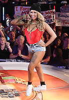 NON EXCLUSIVE PICTURE: MATRIXPICTURES.CO.UK<br /> PLEASE CREDIT ALL USES<br /> <br /> WORLD RIGHTS<br /> <br /> Glamour model Sallie Axl is pictured during the 2013 Big Brother first eviction night, in London.<br /> <br /> Sallie is the first person to be evicted from the Big Brother House, along with undercover actor Michael.<br /> <br /> JUNE 21st 2013<br /> <br /> REF: GBH 134294