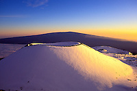 Snowcapped Puu Lilinoe (crater) at 12,987 feet elevation, just below the summit of Mauna Kea, with Mauna Loa in the background