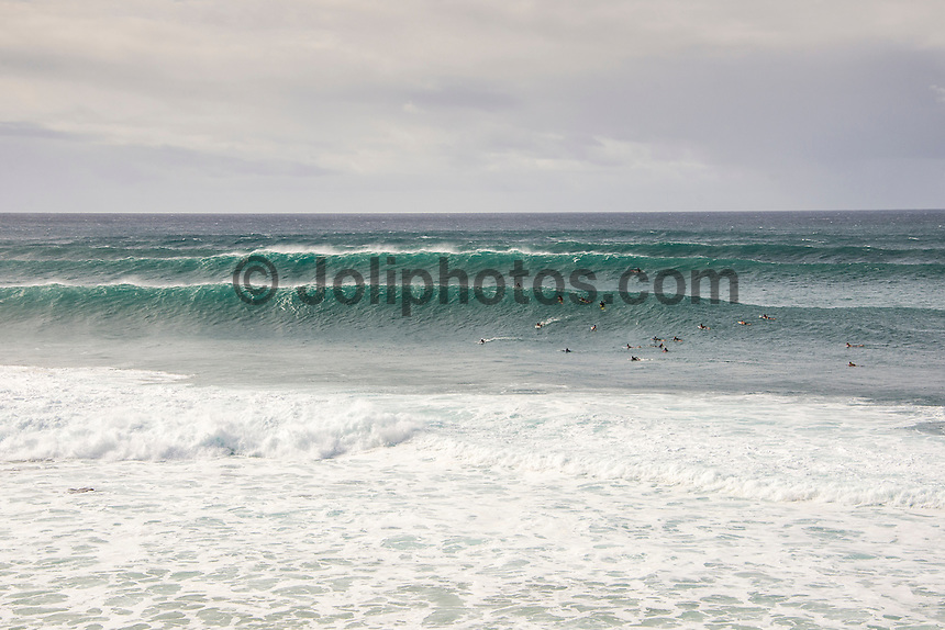 BANZAI PIPELINE, Oahu/Hawaii (Saturday, December 13, 2014) Pipeline lining up after the contest was called off fro the day. - The final stop of the 2014  World Championship Tour, the Billabong Pipe Masters in Memory of Andy Irons, was  called ON today in NW double overhead surf. <br /> Round 1 was completed as the swell continued to rise and the Easterly Trade winds increased in strength. Kelly Slater (USA) kept his World Title hopes alive after winning his heat against Reef MacIntosh (HAW). Jordy Smith(ZAF) was injured when he hit the reef at Backdoor.<br /> Conditions worsen around the end of the Round and the event was first put on hold then postponed for the day.  <br /> <br /> The Billabong Pipe Masters in Memory of Andy Irons will determine this year&rsquo;s world surfing champion as well as those who qualify for the elite tour in 2015. As the third and final stop on the Vans Triple Crown of Surfing Series  the event will also determine the winner of the revered three-event leg.<br /> <br />  Photo: joliphotos.com