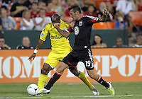 WASHINGTON, DC - AUGUST 4, 2012:  Emilliano Dudar (19) of DC United pokes the ball away from Emilio Renteria (20) of the Columbus Crew during an MLS match at RFK Stadium in Washington DC on August 4. United won 1-0.