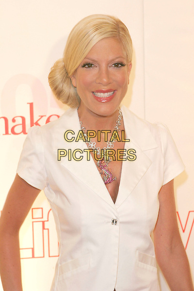 TORI SPELLING.Attends Life & Style Magazine Presents Stylemakers 2005 held at the Monmartre Lounge, Hollywood, California. USA, 26 May 2005. .half length white short sleeved jacket S necklace diamante .Ref: ADM.www.capitalpictures.com.sales@capitalpictures.com.©Zach Lipp /AdMedia/Capital Pictures.