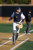 Georgetown Hoyas catcher Nick Collins (33) on defense against the Delaware Blue Hens at Wake Forest Baseball Park on February 13, 2015 in Winston-Salem, North Carolina.  The Blue Hens defeated the Hoyas 3-0.  (Brian Westerholt/Four Seam Images)