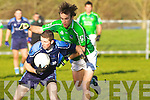 Not for turning. Limerick defender Stephen Lavin has no intention of letting IT Tralee centre forward Damien Wallace out of his grasp in their McGrath Cup match at Moyvane on Sunday.   Copyright Kerry's Eye 2008