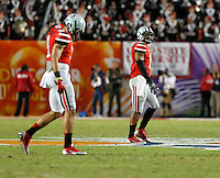 Ohio State Buckeyes quarterback Braxton Miller (5) looks at a replay after throwing an interception to Clemson Tigers linebacker Stephone Anthony (42) in the 4th quarter of their game in the Discover Orange Bowl at Sun Life Stadium in Miami Gardens, Florida on January 3, 2014.(Dispatch photo by Kyle Robertson)