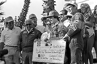 LONG BEACH, CA - APRIL 13: Michael Andretti (center) and Al Unser, Jr., (right) celebrate in Victory Lane after finishing first and second, respectively, in the Toyota Grand Prix of Long Beach CART Indy Car race on the temporary Long Beach Street Circuit in Long Beach, California, on April 13, 1986.