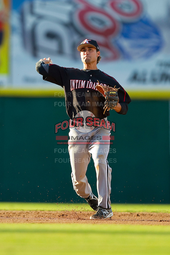 Kannapolis Intimidators shortstop Michael Johnson (5) makes a throw to first base against the Hickory Crawdads at L.P. Frans Stadium on May 25, 2013 in Hickory, North Carolina.  The Crawdads defeated the Intimidators 14-3.  (Brian Westerholt/Four Seam Images)