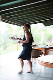 FRENCH POLYNESIA, Raiatea Island. A waitress serving breakfast at the Raiatea Lodge.