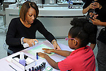 Alicia Jones works on Adaobi Achugo's nails at the Saks Fifth Avenue Key to the Cure Wednesday Oct. 26,2016.(Dave Rossman photo)