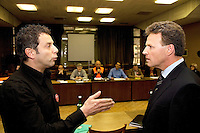 """Switzerland. Canton Ticino. Biasca. City Hall (Casa communale). Meeting between CEO Andreas Meyer (right) of the SBB CFF FFS and Ivan Cozzaglio (left), vice mayor of Biasca, and the workers on strike of SBB CFF FFS Cargo from the committee """" Giù le mani dall'Officina di Bellinzona"""" (center). Ivan Cozzaglio is also working at the Officine FFS and is also a striker. © 2008 Didier Ruef"""
