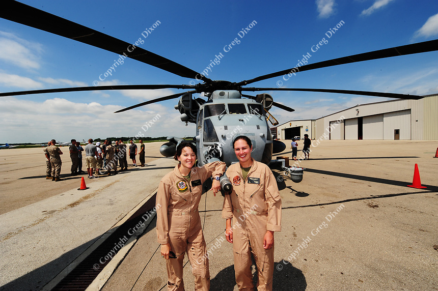 The helicopter is piloted by Wisconsin native Major Jodi (Miller) Maroney (right) and her copilot Major Brietta Walker (left).