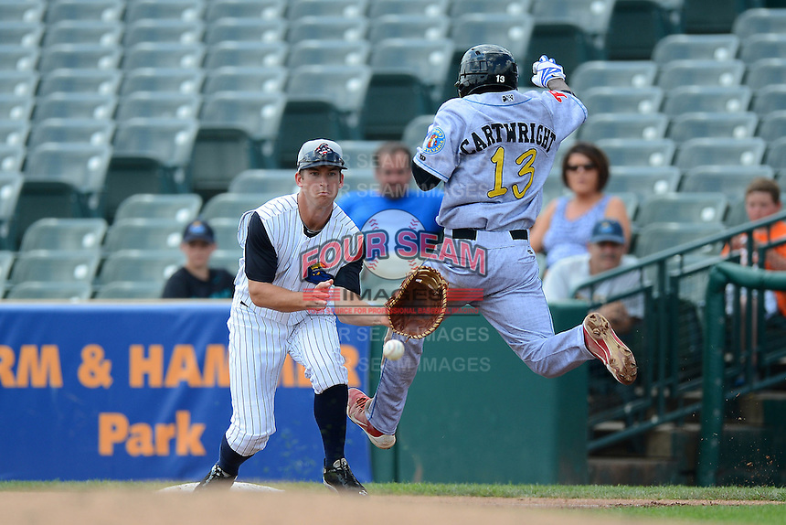 Trenton Thunder first baseman Casey Stevenson #31 waits for a throw as Albert Cartwright #13 runs through the bag during a game against the Reading Fightin Phils on July 8, 2013 at Arm & Hammer Park in Trenton, New Jersey.  Trenton defeated Reading 10-6.  (Mike Janes/Four Seam Images)