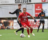 FC GULLEGEM - RC GENT :<br /> Indy Vancraeyveldt (R) draait weg van Raf Leemans (L)<br /> <br /> Foto VDB / Bart Vandenbroucke