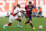 Rayo Vallecano´s Kakuta (L) and Barcelona´s Leo Messi during La Liga match between Rayo Vallecano and Barcelona at Vallecas stadium in Madrid, Spain. October 04, 2014. (ALTERPHOTOS/Victor Blanco)