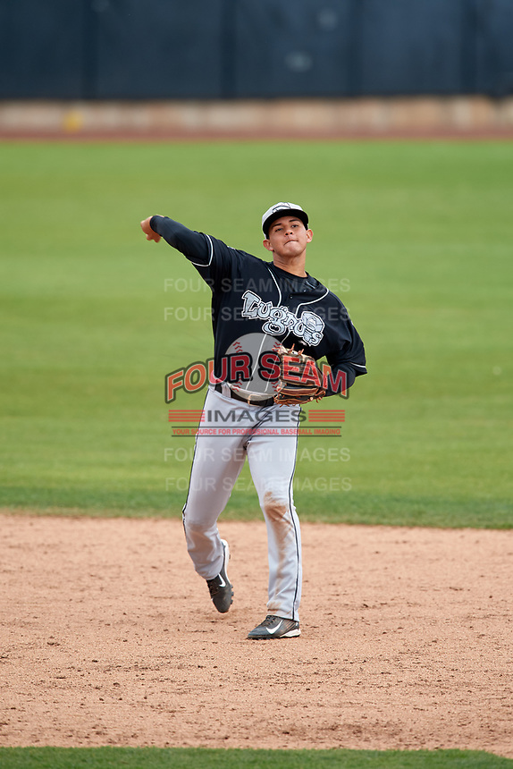Lansing Lugnuts shortstop Yeltsin Gudino (5) throws to first base during a game against the Clinton LumberKings on May 9, 2017 at Ashford University Field in Clinton, Iowa.  Lansing defeated Clinton 11-6.  (Mike Janes/Four Seam Images)