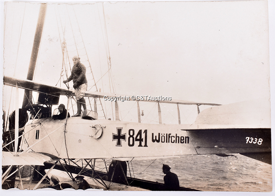 Bmth News (01202 558833)<br /> Picture:  C&TAuctions/BNPS<br /> <br /> 'Wolfchen' (Little Wolf) a German biplane carried by the Cruiser SMS Wolf.<br /> <br /> Remarkable photographs revealing how the Germans used captured British tanks against us because theirs were no good have come to light over 100 years later.<br /> <br /> The British were the first to invent the tank in 1916 and a year later used them to overwhelm the enemy at the Battle of Cambrai in the First World War.<br /> <br /> Although the battle was a success for the British, the Germans captured several Mark IV tanks.<br /> <br /> Now black and white photos have emerged to show the German high command inspecting one the hulking machines in Berlin in 1918.<br /> <br /> Other pictures in the album depicts the early days of aerial warfare when hand grenades were dropped over the side of the cockpits by German pilots.