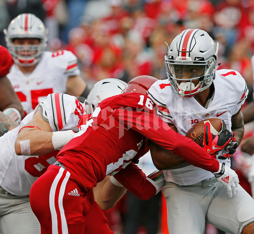 Ohio State Buckeyes wide receiver Braxton Miller (1) gts caught up by Indiana Hoosiers defensive back Rashard Fant (16) in the first of the Ohio State Buckeyes against the Indiana Hoosier at Memorial Stadium in Bloomington Indiana Oct. 3, 2015.(Dispatch photo by Eric Albrecht)