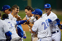 Dunedin Blue Jays Ryan Noda (19) celebrates with teammates after hitting a walk off grand slam home run in the bottom of the ninth inning during a Florida State League game against the Jupiter Hammerheads on May 15, 2019 at Jack Russell Memorial Stadium in Clearwater, Florida.  Dunedin defeated Jupiter 8-4 in nine innings, the second game of a doubleheader.  (Mike Janes/Four Seam Images)