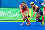 Kelsey Kolojejchick #7 of United States contests for the ball during Great Britain vs USA in a women's Pool B game at the Rio 2016 Olympics at the Olympic Hockey Centre in Rio de Janeiro, Brazil.