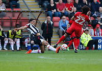 Grimsby Town's Brandon Comley and Leyton Orient's Sandro Semedo go for the 50/50 during the Sky Bet League 2 match between Leyton Orient and Grimsby Town at the Matchroom Stadium, London, England on 11 March 2017. Photo by Carlton Myrie / PRiME Media Images.