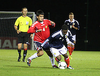 Islam Feruz and Aram Shakhnazaryan challenge in the Scotland v Armenia UEFA European Under-19 Championship Qualifying Round match at New Douglas Park, Hamilton on 9.10.12.