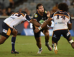 Sharks player Marius Louw (C) is tackled by Brumbies players Tevita Kuridrani (L) and Henry Speight (R)  during the Super Rugby match between the ACT Brumbies and the South African Sharks in Canberra on March 17, 2018. AFP PHOTO / MARK GRAHAM --- IMAGE RESTRICTED TO EDITORIAL USE - STRICTLY NO COMMERCIAL USE --