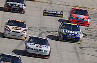Sept. 21, 2008; Dover, DE, USA; Nascar Sprint Cup Series driver Jimmie Johnson (48) and Jeff Burton (31) go low to avoid the flying rear bumper from the car of Sam Hornish Jr (77) during the Camping World RV 400 at Dover International Speedway. Mandatory Credit: Mark J. Rebilas-