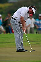 Phil Mickelson (USA) takes his putt on the 3rd green during Friday's resumed Round 2 of the 2011 Barclays Singapore Open, Singapore, 11th November 2011 (Photo Eoin Clarke/www.golffile.ie)