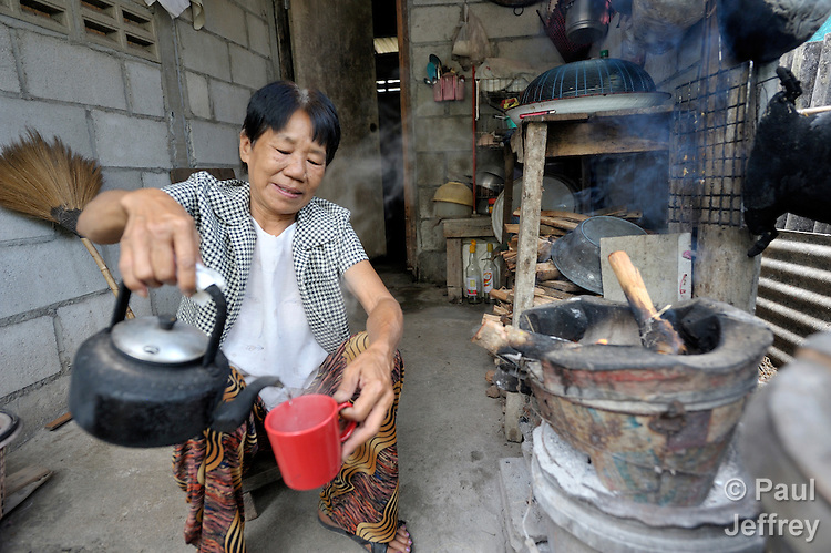 Pranom Kantawong, a woman living with HIV, makes tea in her home in the city of Chiang Mai, Thailand.
