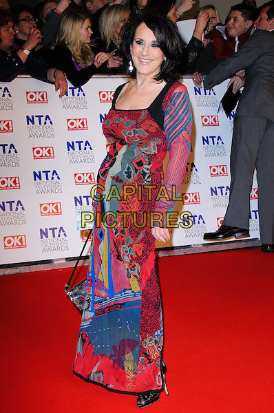 Lesley Joseph.arrivals at The National Television Awards, O2 Greenwich, London, England. 25th January 2012.NTA NTAS full length dress red pink blue green print pattern side.CAP/CJ.©Chris Joseph/Capital Pictures.
