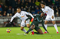 Jordan Ayew of Swansea City and Yaya Toure of Manchester City during the EPL - Premier League match between Swansea City and Manchester City at the Liberty Stadium, Swansea, Wales on 13 December 2017. Photo by Mark  Hawkins / PRiME Media Images.