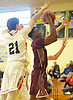 De'Shawn Todman #12 of Deer Park, right, drives to the net as James Kesicier #21 of South Side challenges his shot during a non-league varsity boys basketball game in the Richard Brown Nassau-Suffolk Challenge at Uniondale High School on Saturday, Jan. 13, 2018.