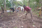 As her family prepares to plant corn, a girl turns up the soil in a camp for more than 5,000 displaced people in Riimenze, in South Sudan's Gbudwe State, what was formerly Western Equatoria. Families here were displaced at the beginning of 2017, as fighting between government soldiers and rebels escalated.<br /> <br /> Two Catholic groups, Caritas Austria and Solidarity with South Sudan, have played key roles in assuring that the displaced families here have food, shelter and water.