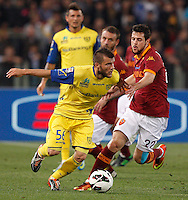 Calcio, Serie A: Roma vs Chievo Verona. Roma, stadio Olimpico, 7 maggio 2013..ChievoVerona midfielder Perparim Hetemaj, of Finland, and AS Roma forward Mattia Destro, right, fight for the ball during the Italian Serie A football match between AS Roma and ChievoVerona at Rome's Olympic stadium, 7 May 2013..UPDATE IMAGES PRESS/Riccardo De Luca