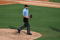 Home plate umpire Emil Jimenez works a game between the Hickory Crawdads and Greenville Drive on Sunday, July 16, 2017, at Fluor Field at the West End in Greenville, South Carolina. Hickory won, 3-1. (Tom Priddy/Four Seam Images)