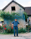 FRANCE, Baume les Messieurs, a local Frenchman in front of his home in the village, Jura Wine Region