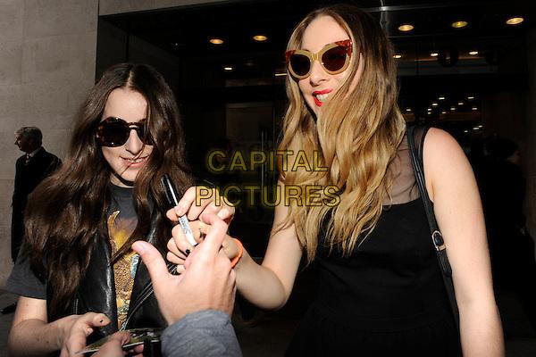 LONDON, UK - FEBRUARY 25 - Haim (Este Arielle, Danielle Sari and Alana Mychal) arriving at the Radio One Studios, London, on Tuesday,  February 25, 2014. <br /> CAP/IA<br /> &copy;Ian Allis/Capital Pictures