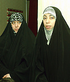 McLean, VA - December 13, 2005 -- Betool Alwan, left, and Tuka Al-Sahlani, right, wait for their husbands after voting in the Iraqi election in McLean, Virginia on December 13, 2005. Their husbands are Imam Fadhel Al Sahlani and Imam Maan Al Sahlani of New York, New York..Credit: Ron Sachs / CNP.(RESTRICTION: NO New York or New Jersey Newspapers or newspapers within a 75 mile radius of New York City)