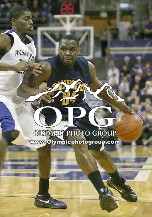 16 January 2010:  Washington Huskies forward #22 Justin Holiday tries to slow down California's #24 Theo Robertson as he moves the ball round the key. Washington won 84-69 over California at the Bank of America Arena in Seattle, WA.