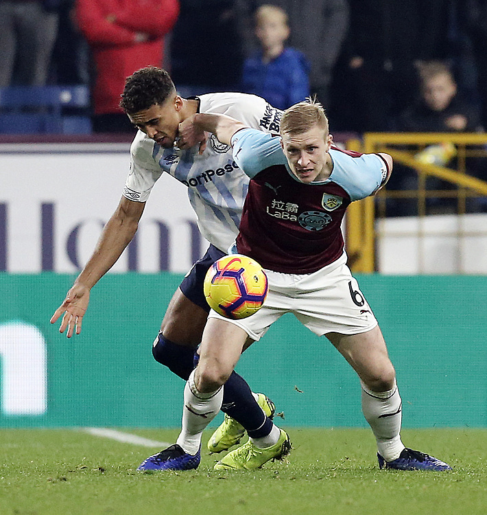Burnley's Ben Mee shields the ball from Everton's Dominic Calvert-Lewin<br /> <br /> Photographer Rich Linley/CameraSport<br /> <br /> The Premier League - Burnley v Everton - Wednesday 26th December 2018 - Turf Moor - Burnley<br /> <br /> World Copyright © 2018 CameraSport. All rights reserved. 43 Linden Ave. Countesthorpe. Leicester. England. LE8 5PG - Tel: +44 (0) 116 277 4147 - admin@camerasport.com - www.camerasport.com