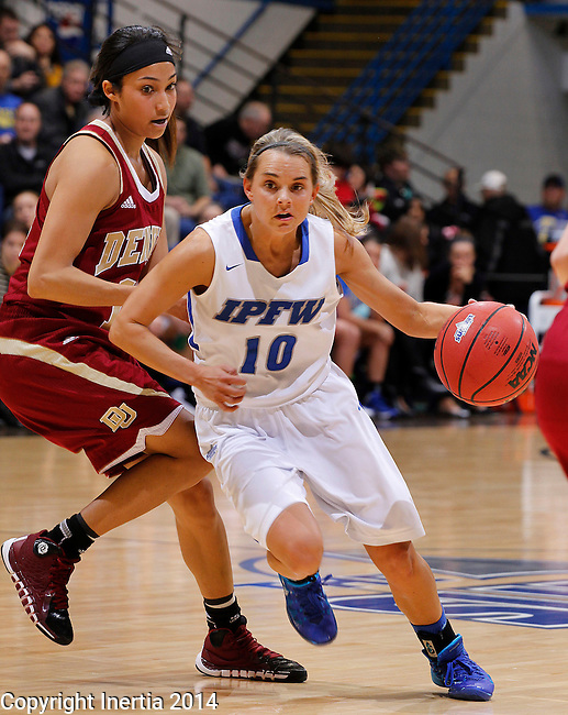 SIOUX FALLS, SD - MARCH 9:  Haley Seibert #10 of IPFW drives past Kailey Edwards #14 of Denver during their quarterfinal game at the 2014 Summit League Basketball Championships Sunday at the Sioux Falls Arena.  (Photo by Dick CarlsonInertia)