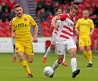 Fleetwood Town's Lewis Coyle puts pressure on Doncaster Rovers' Matty Blair<br /> <br /> Photographer David Shipman/CameraSport<br /> <br /> The EFL Sky Bet League One - Doncaster Rovers v Fleetwood Town - Saturday 6th October 2018 - Keepmoat Stadium - Doncaster<br /> <br /> World Copyright &copy; 2018 CameraSport. All rights reserved. 43 Linden Ave. Countesthorpe. Leicester. England. LE8 5PG - Tel: +44 (0) 116 277 4147 - admin@camerasport.com - www.camerasport.com