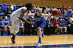 24 March 2014: DePaul's Megan Podkowa (30) knocks the ball away from Duke's Elizabeth Williams (left). The Duke University Blue Devils played the DePaul University Blue Demons in an NCAA Division I Women's Basketball Tournament Second Round game at Cameron Indoor Stadium in Durham, North Carolina.