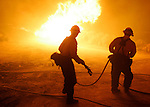 Firefighters confront hot  flames from the Crown Fire as it burns near Leona Valley in northeast Los Angeles County in July, 2010