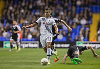 Erik Lamela of Tottenham Hotspur heads forward after shaking off Maksim Medvedev  of Qarabag FK during the UEFA Europa League match between Tottenham Hotspur and Qarabag FK at White Hart Lane, London, England on 17 September 2015. Photo by Andy Rowland.