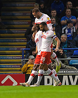 Rotherham United  players mob goalscorer Freddie Ladapo of Rotherham United after making the score 1-1-  during Portsmouth vs Rotherham United, Sky Bet EFL League 1 Football at Fratton Park on 26th November 2019