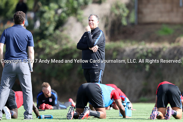 11 January 2017: Head coach Bruce Arena (center) talks to press officer Michael Kammarman (left). The United States Men's National Team held their first training session under new head coach Bruce Arena on The Murphy Family Field at the StubHub Center in Carson, California.