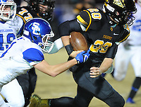 NWA Democrat-Gazette/ANDY SHUPE<br /> Blake Faulk (20) of Prairie Grove carries the ball as Blake Wynn of Star City attempts to strip the ball Friday, Nov. 27, 2015, during the first half of play at Tiger Stadium in Prairie Grove. Visit nwadg.com/photos to see more photographs from the game.