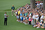 AUGUSTA, GA - APRIL 11:  The gallery follow the ball of Tiger Woods of the USA on the fairway after he hits out of the rough during the First Round of the 2013 Masters Golf Tournament at Augusta National Golf Club on April 10in Augusta, Georgia. Tiger Woods, even though favored was never in contention for the lead going into the final round. Adam Scott became the first Australian ever to win the famed Masters Golf Tournament , one of the four major championships, in it's 79 year history.
