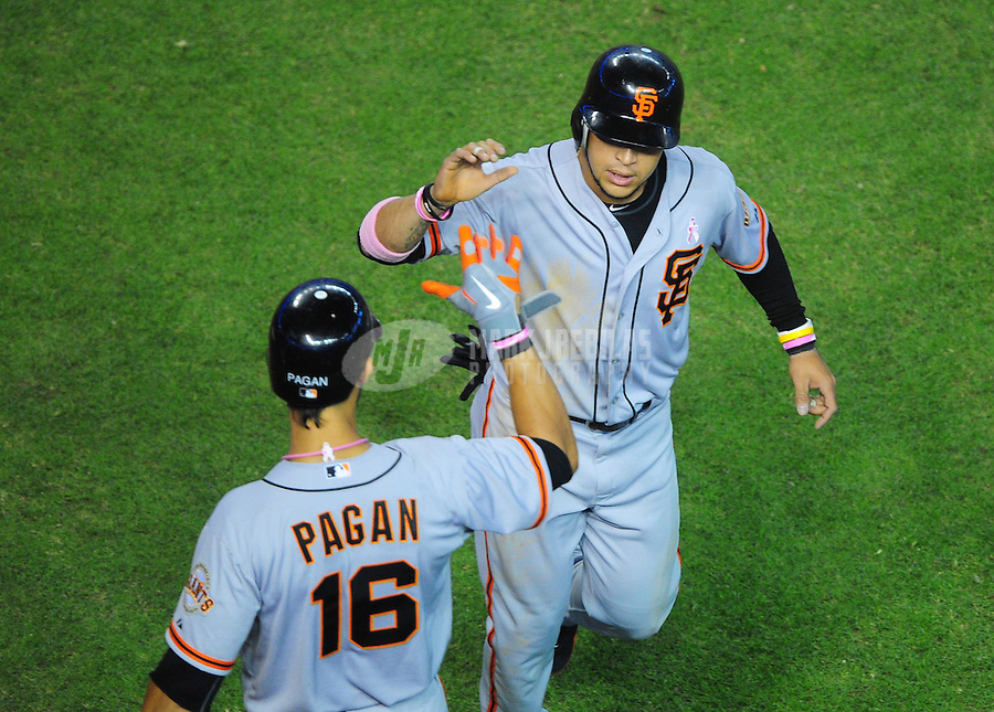 May 13, 2012; Phoenix, AZ, USA; San Francisco Giants outfielder Gregor Blanco (right) is congratulated by Angel Pagan after scoring in the third inning against the Arizona Diamondbacks at Chase Field. Mandatory Credit: Mark J. Rebilas-